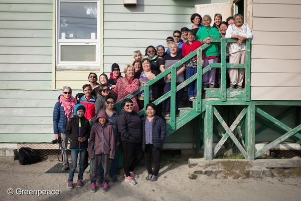 Elders, staff and local residents with Greenpeace crew and guests at Ilisaksivik community centre, in Clyde River. 16/08/2016 © Greenpeace