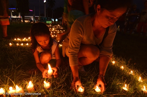 "On the eve of the Super Typhoon Haiyan's 3rd year anniversary, people from Tacloban light a candle that spells out ""Climate Justice"" to commemorate the devastating landfall three years ago."
