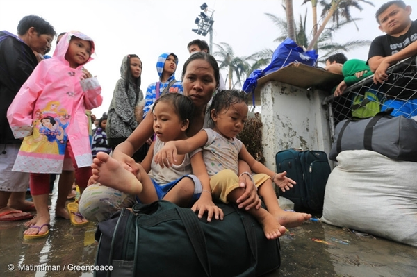 Tacloban City residents wait at the airport as they try to get a seat on outgoing C130 planes bound to Manila. Supplies have been scarce particularly water for the last four days and many are wanting to leave the city.