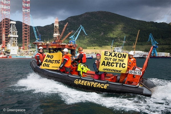 Greenpeace activists protest in the fjord at Ölen near Haugesund, Norway. Drilling rig West Alpha, commissioned by Exxon Mobil, is being prepared for extreme oil drilling in the Arctic.