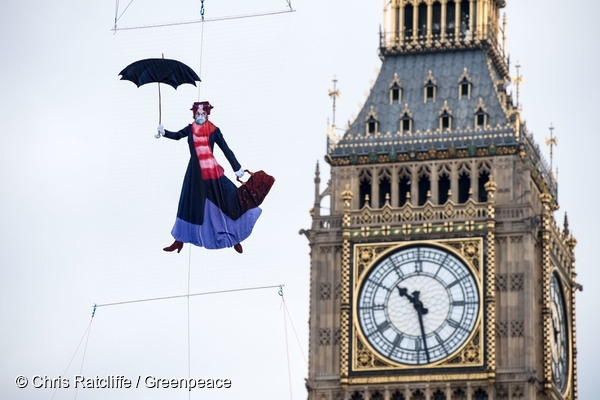 Mary Poppins in air pollution mask flies over Westminster to highlight air pollution in the UK,