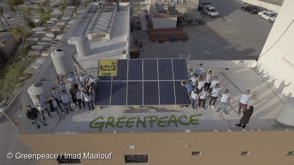 Family picture on the roof with solar installation. 07/03/2016 © Greenpeace / Imad Maalouf