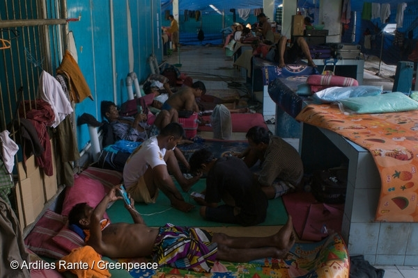 Burmese fishermen in temporary shelter in Ambon port, Indonesia. Hundreds of trafficked workers are waiting to be sent back home, with many facing an uncertain future. 26 Sep, 2015 © Ardiles Rante / Greenpeace
