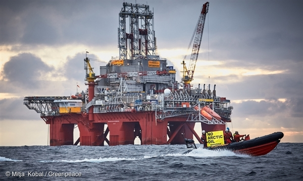 """Activists from the Greenpeace Arctic Sunrise protest the oil drilling operations of the Austrian OMV in the Arctic Ocean near Bear Island. The banner reads : """"No Arctic Oil""""."""