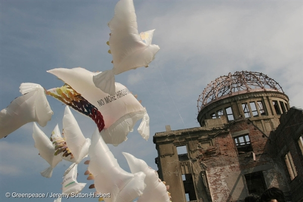 """Peace doves fly on the eve of the 60th Anniversary of the Hiroshima Atomic Bombing in 2005. The message of peace reads: """"No More Hiroshima"""""""