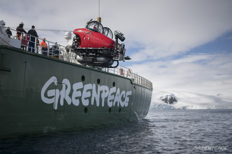 Dr. Susanne Lockhart and submarine pilot Kenneth Lowyck in the cockpit of a submarine that is being launched from Greenpeace vessel the Arctic Sunrise, outside Joinville Island in the Antarctic Sound at the opening of the Weddell Sea. Greenpeace is conducting submarine-based scientific research to strengthen the proposal to create the largest protected area on the planet, an Antarctic Ocean Sanctuary.