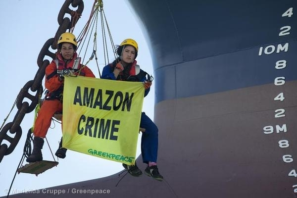 Q'orianka with Greenpeace banner