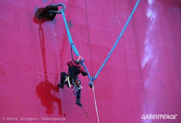 Activists hanging from Gazprom oil platform.