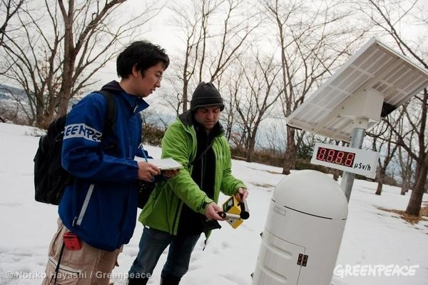Greenpeace radiation monitoring team member Heinz Smital (right) checks contamination levels around an official government radiation monitoring station in a park in Watari, a suburb of Fukushima City, in March, 2012.