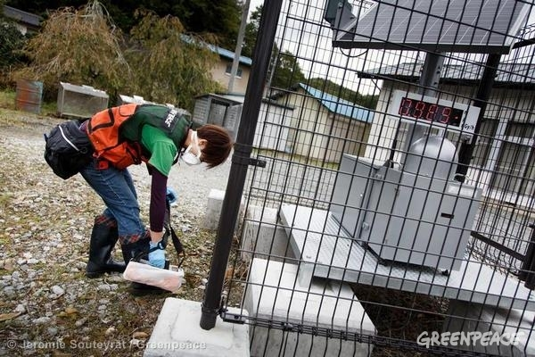 A Greenpeace radiation monitoring team checks contamination levels around an official government monitoring station in Iitate village, 40km from the site of the triple meltown at the Fukushima Daiichi nuclear power plant. Greenpeace has been conducting ongoing radiation monitoring in the Fukushima region since the disaster in 2011 to monitor and assess the ongoing threat to the population and environment. Iitate, Japan, October 18, 2012