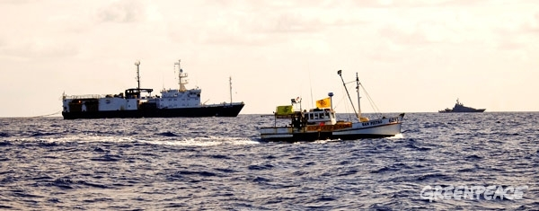 """Stop Deep Sea Oil"" flotilla vessell San Pietro shadowing the seismic survey ship Orient Explorer, watched by the New Zealand navy patrol vessel HMNZS Taupo off East Cape."