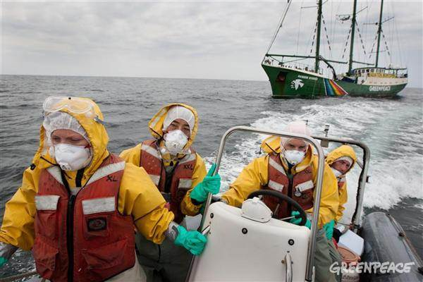 Left to right: Giorgia Monti of Greenpeace Italy (far left of pic), Sakyo Noda of Greenpeace Japan, Tuomas Heikkila (driving boat), Jacob Namminga (at rear of boat). Crew from the Rainbow Warrior collect sea water and seaweed samples to monitor for radiation contamination levels as the Greenpeace ship sails up the eastern coast of Japan, in the vicinity of Fukushima.