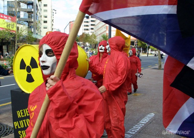 Greenpeace activists march to the British Consul General