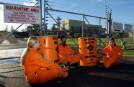 Greenpeace activists chained to the entrance of Auckland Airport incinerator
