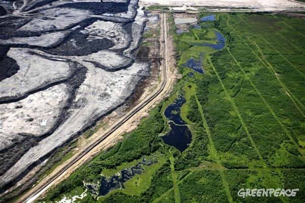 Aerial view of seismic lines and a tar sands mine in the Boreal forest north of Fort McMurray, northern Alberta.