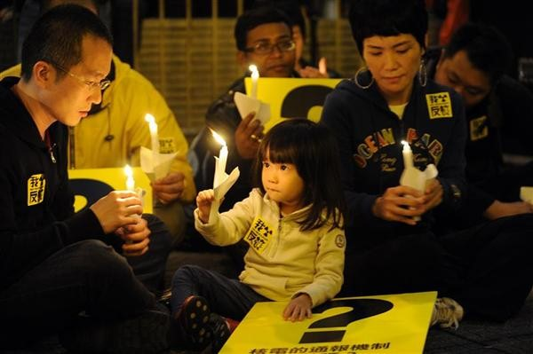 Hong Kong citizens, legislators and social groups join Greenpeace in a candlelit vigil held in Central Statue Square. The group offers condolences and support for the victims of the massive earthquake and nuclear disaster in Japan.