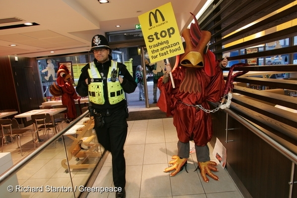 Greenpeace activists dressed as seven-foot tall chickens invade a McDonald's outlet in Birmingham after a new report revealed the role played by the fast food giant in the destruction of the Amazon rainforest. McDonald's chicken products are produced from chickens that are fed on soya that comes from the Amazon rainforest. 6 Apr, 2006  © Richard Stanton / Greenpeace