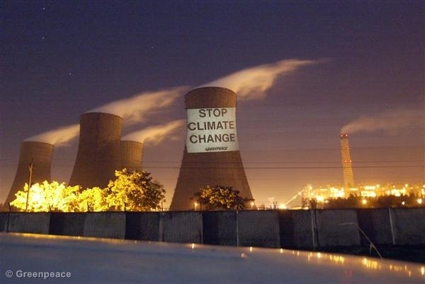 In an earlier protest Greenpeace activists project a message to stop climate change on a cooling tower of the National Thermal Coal Plant.