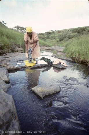 Woman washing clothes in Mngeweni stream, polluted with mercury from Thor. Natal