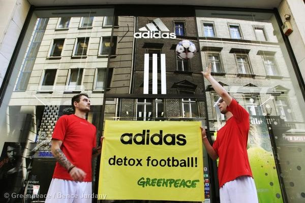 Greenpeace CEE activists protest at an adidas store in Budapest.