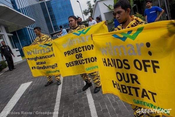 "Greenpeace South East Asia activists dressed up as tigers holding banners reading: 'Hands off our habitat"" and 'Protection or destruction"" outside Wilmar International in Jakarta."