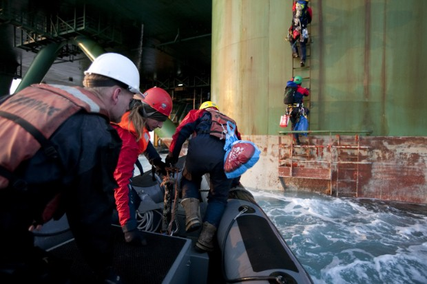 4/06/2011 MY Esperanza Baffin Bat Greenland = Greenpeace activists boarding the Oil Drill Rig Leiv Eirikkssson to ask the crew if they have a copy of the Oil Response Plan prepared by Cairn which has not been made public
