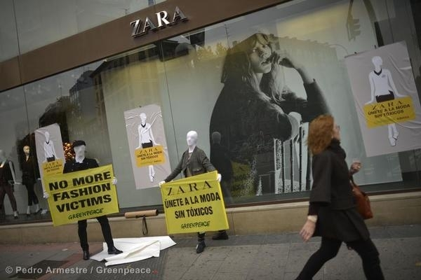 Greenpeace activists dressed as mannequins hold banners reading: 'No More Fashion Victims' in front of one of the main Zara stores in Madrid.