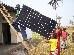 installation of solar panel for the radio in Oshwe, part of volunteers training