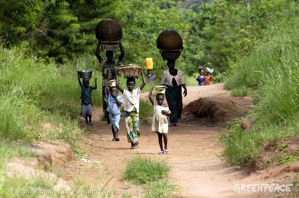 People walking on a road in DRC rainforest.
