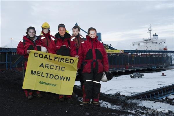 World leaders unfurl a banner reading 'Coal-fired Arctic meltdown' at Svea, Svalbard - 75 degrees North. The activists are supporting Greenpeace's call for a commitment of $140bn a year from developed nations to fund adaption, mitigation and forest pr...