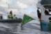 Greenpeace activists hang a banner on the