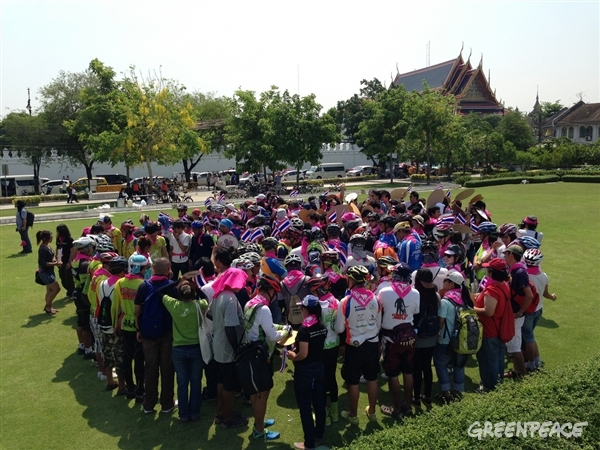 Volunteers in Bangkok, Thailand getting ready to form a heart