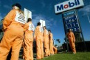 Greenpeace activists picket a Mobil petrol station