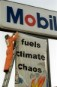Greenpeace activists alter Mobil signage
