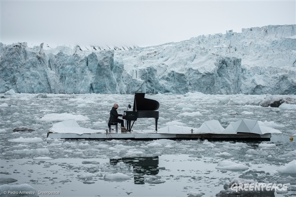 Acclaimed Italian composer and pianist Ludovico Einaudi performs one of his own compositions on a floating platform in the Arctic Ocean, in front of the Wahlenbergbreen glacier (in Svalbard, Norway).  The composition, Elegy for the Arctic, was inspired by eight million voices from around the world calling for Arctic protection. The Greenpeace ship the Arctic Sunrise carried Einaudi, the grand piano and eight million voices to Svalbard.