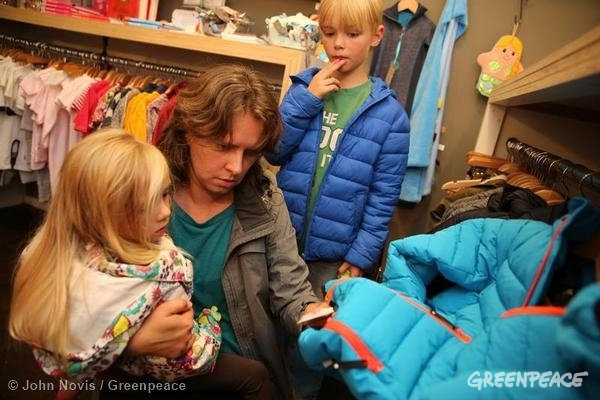 Shopping For School Clothes Parents and their two children shop for new school clothes. Greenpeace is campaigning to Detox the textile industry of hazardous chemicals such as polyflourinated chemicals (PFCs), a substance often used to make clothes and other products stain and water resistant. As a result of the campaign 20 fashion companies have committed to eliminate hazardous chemicals from their products. 08/21/2014 © John Novis / Greenpeace