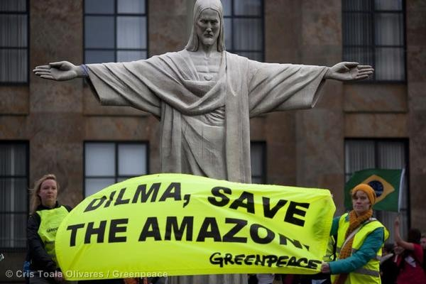 November 29, 2011 - Greenpeace activists march with a 4 meter high replica of the Rio de Janeiro Christo Redendor statue from the biggest square in the Hague -the 'Malieveld'- to the Brazilian embassy. Image: Cris Toala Olivares
