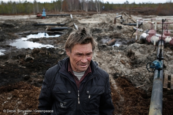 Sergey Kechimov stands by an oil spill at Rosneft fields near Pyt'-Yah, Khanty-Mansi region, Siberia. Daily oil spills have turned thousands of hectares of forests and wetlands into an environmental disaster zone in just a matter of years. © Denis Sinyakov / Greenpeace