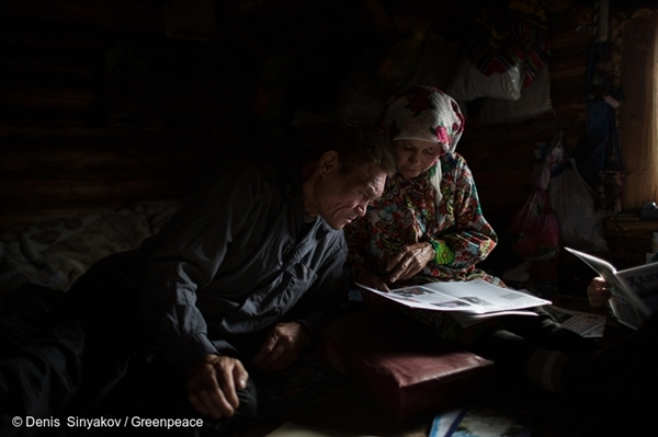 Capitalina and Sergey Kechimov at their home in Surgut district, Khanty-Mansi Autonomous Region, Siberia. Their log cabin is the last occupied home on the banks of Lake Imlor. Their neighbours moved away as the oil industry advanced. © Denis Sinyakov / Greenpeace