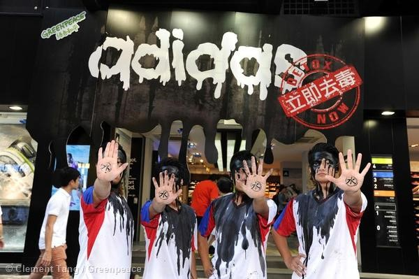 adidas caught playing dirty - protest outside a store in Hong Kong.