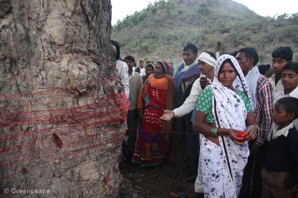 Mahan villagers tie a thread