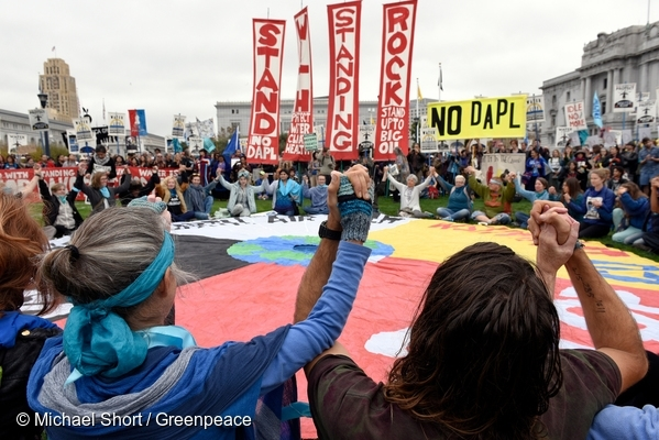 People gather in San Francisco for a closing ceremony in support of the Standing Rock Nation. The protest was one of many in a global day of action calling on the U.S. Army Corps of Engineers to cancel the permits for the Dakota Access Pipeline. 15 Nov, 2016  © Michael Short / Greenpeace
