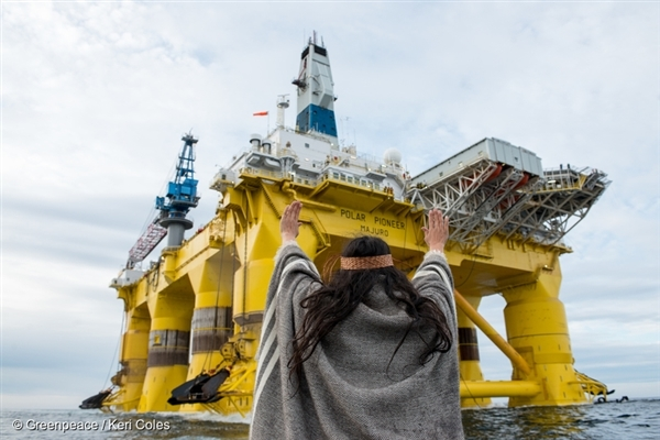 Audrey Siegl, a Musqueam woman from British Columbia, Canada, takes action in the Pacific Ocean against Shell's oil rig, the Polar Pioneer, as part of the global movement #PeopleVsOil determined to protect and Save The Arctic. 17 Jun, 2015 © Greenpeace / Keri Coles
