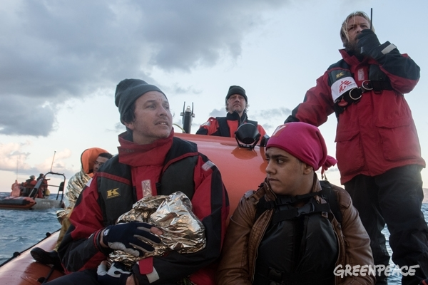 A MSF nurse holds a 2 month old baby who was one of those rescued. They will be reunited with the family at  the port. © Greenpeace