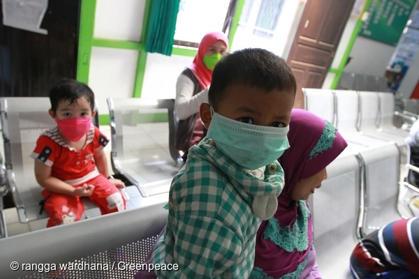 Children line-up for a health check up at the Public Health Center in Jl Alianyang, Pontianak, West Kalimantan. West Kalimantan's Department of Health data last August 2015 show that a number of patient have acute respiratory infection cases throughout West Kalimantan. 19 Sep, 2015