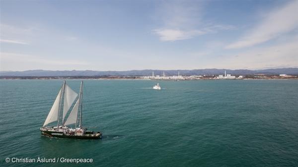 Greenpeace Ship Rainbow Warrior Sailing past the destroyed Fukushima Daiichi nuclear plant