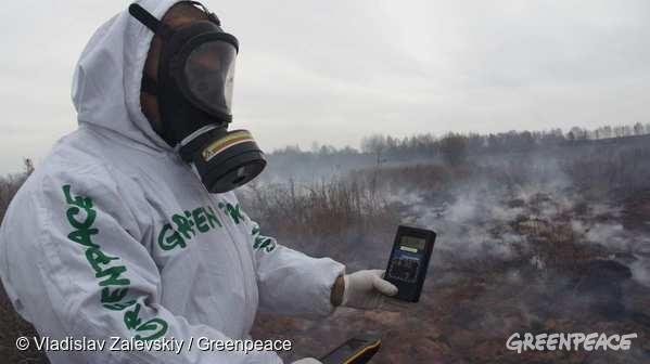 A Greenpeace member wearing protective clothing holds a geiger counter. 07/04/2016  © Vladislav Zalevskiy / Greenpeace