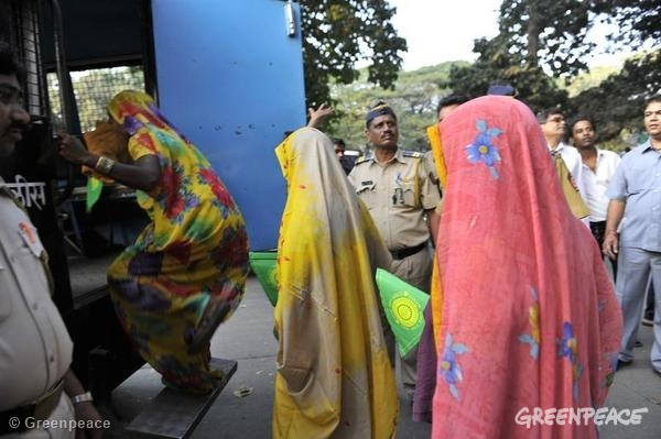 Villagers from Mahan, India, being arrested along with Greenpeace activitsts and volunteers for protesting coal mine plans