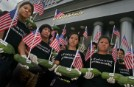 Greenpeace volunteers hold papayas and American