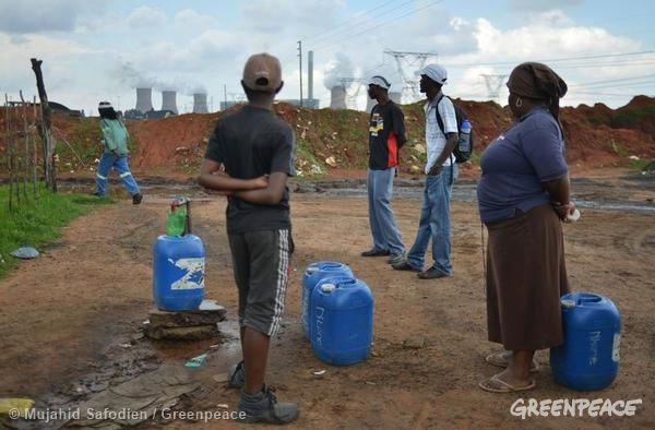 Water Pond at Informal Settlement in South Africa. 12/06/2013 © Mujahid Safodien / Greenpeace